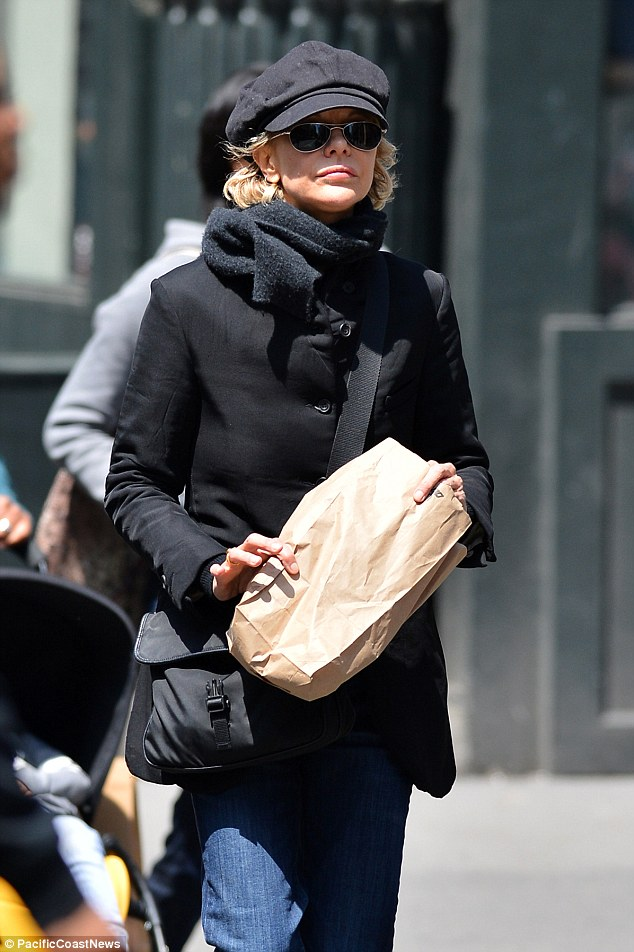 Low profile: Meg Ryan covers up on Friday as she takes a stroll around Soho, New York