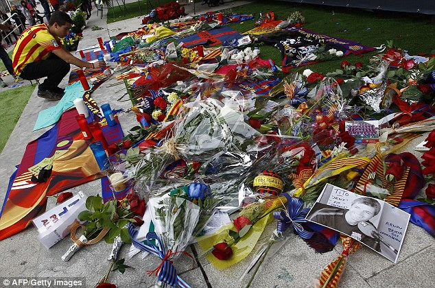 Memorabilia: Mourning fans place flowers, candles and pictures at the Camp Nou