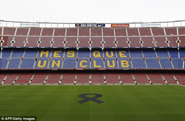 Never forgotten: A black sache placed in the centre circle of the Nou Camp pitch