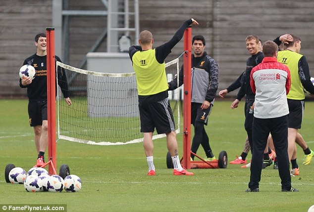 Lead up: Players are seen laughing at Skrtel doing imitations, but Suarez is seen scowling at the Slovakian