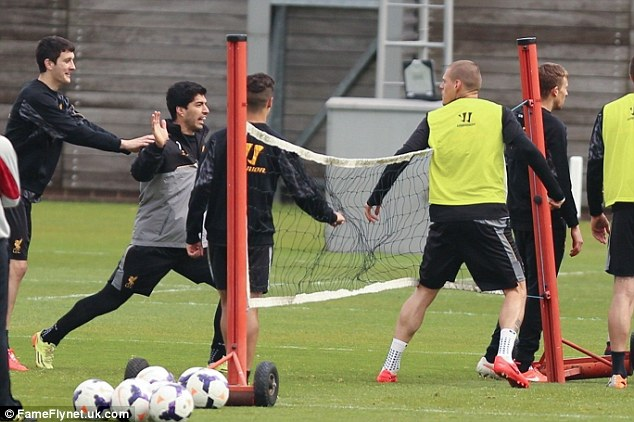 Tempers fray: An eye witness said that Skrtel cheated in the game and Suarez wasn't impressed