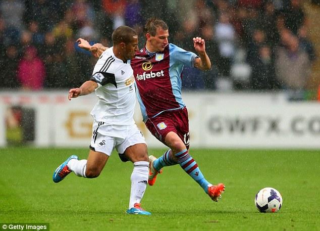 Clash: Swansea winger Wayne Routledge and Aston Villa's Marc Albrighton tussle