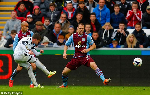 Accuracy: Pablo Hernandez scores Swansea's third goal against Villa as Ron Vlaar can only watch on