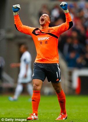 Get in: Swansea goalkeeper Michel Vorm enjoys his side's third goal