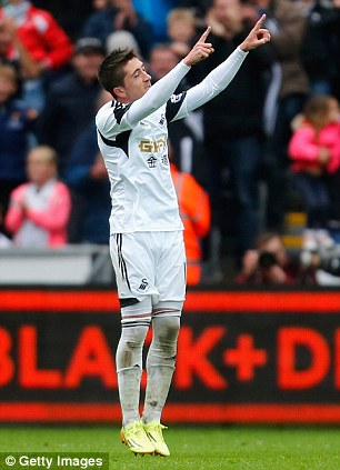 Making a point: Hernandez salutes the crowd after scoring Swansea's third goal against Villa