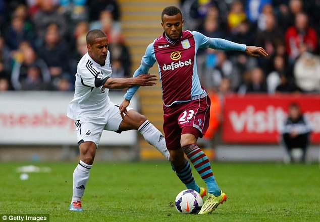 Fight for possession: Routledge, left, and Villa full back Ryan Bertrand tangle during the match at the Liberty Stadium