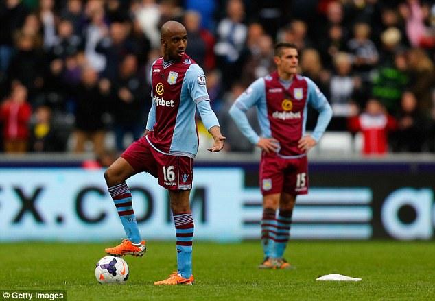 Pain of defeat: Villa midfielder Fabian Delph looks on after Bony scored Swansea's fourth