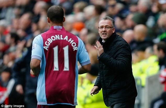 Lone bright spot: Villa boss Paul Lambert speaks to goalscorer Agbonlahor