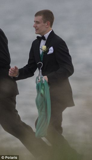 Different duty: Maren's junior prom date Jarrod Butts was seen bringing the dress she was so eager to wear to the beachside memorial service held Friday night