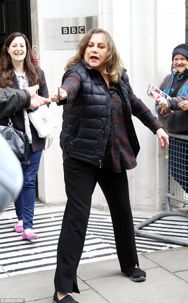 Too much? The 59-year-old actress appeared overwhelmed as she handed her bag to her assistant and signed autographs for fans waiting in front of the studio entrance