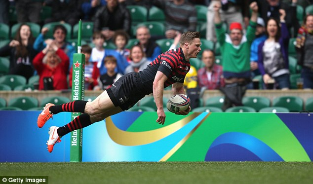 Incoming: Saracens' Chris Ashton dives over for the opening try in the Heineken Cup semi at Twickenham