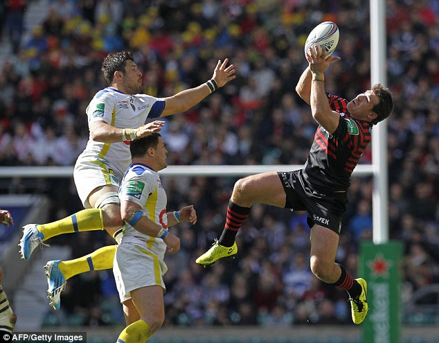 Safe pair of hands: Saracens' Argentinian centre Marcelo Bosch (right) catches the ball