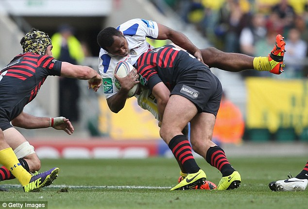Brute force: Clermont's Sitiveni Sivivatu can do nothing as he is tackled by Schalk Brits