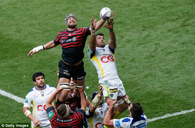 Within reach: Saracens' Alistair Hargreaves (left) tries to grab the ball from Damien Chouly