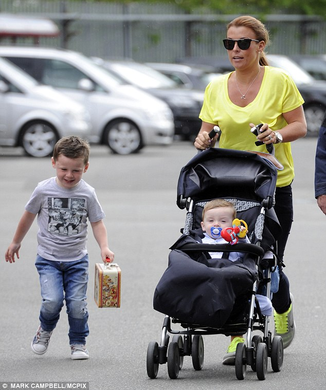 Hard to miss: Coleen teamed her vibrant top with black jeans and kept a yellow theme as she wore grey trainers with equally as vibrany yellow laces