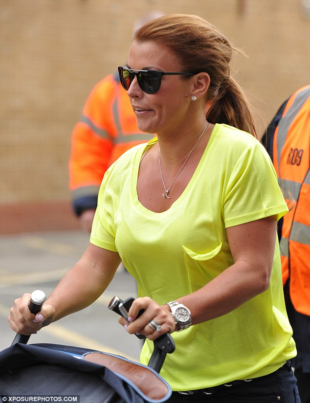 Wrong colours: The 28-year-old unwittingly wore the team colours of her husband's opposition as she headed into Old Trafford stadium