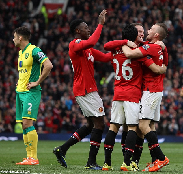 Oops: Coleen wore the yellow colour of the Canaries, rather than the red of her goal-scoring husband Wayne Rooney