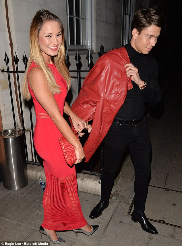 Incredible: Sam showed off her amazing curves in a tight, knitted red dress