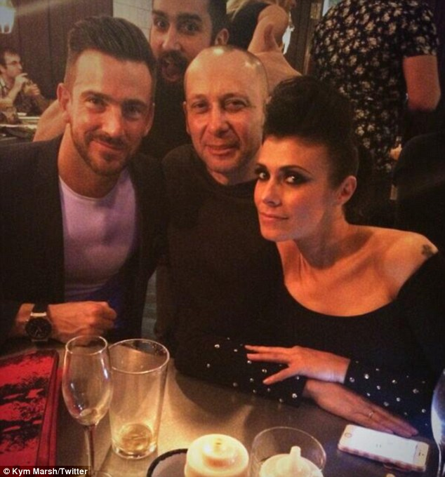 Hitting back: Kym Marsh has dismissed claims that she is in a relationship with personal trainer Dan Hooper, seen here on the far left, after being branded 'heartless' by his ex-girlfriend, Hollyoaks star Stephanie Waring