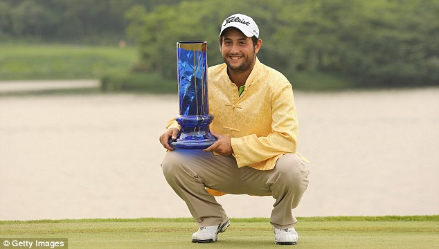 All smiles: Alexander Levy claimed his first European Tour title on Sunday by winning the Volvo China Open