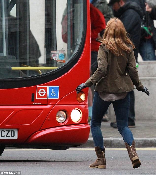 How not to catch a bus: Emily Berrington has a narrow escape - or does she?