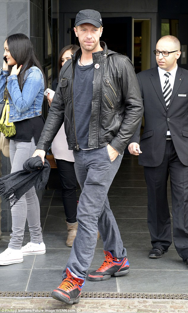 Ready to talk: Coldplay frontman Chris Martin - seen outside his hotel in Germany on Saturday - has spoken about his split from Gwyneth Paltrow in a new interview