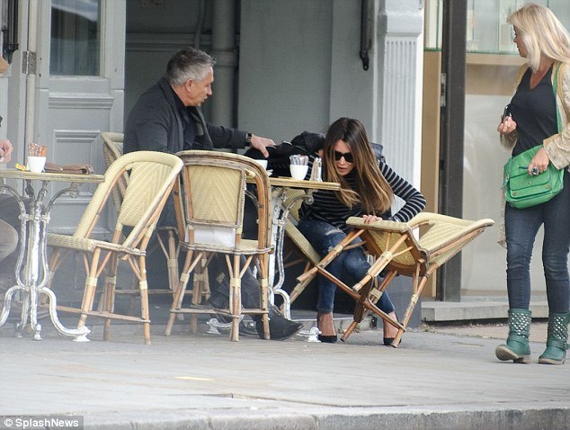 Watch out: A passerby watches as the model and TV personality suffers a calamity over coffee