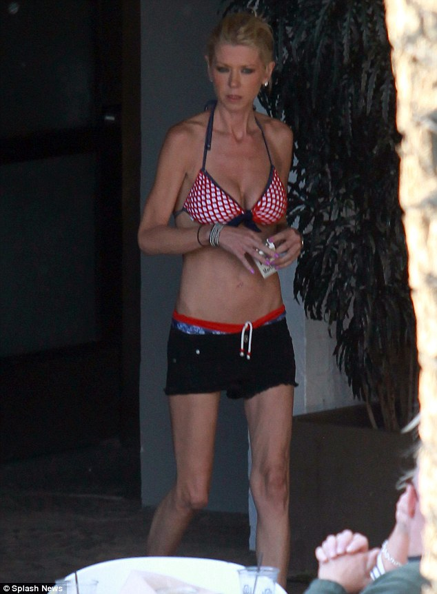Not been eating any American Pie: Tara Reid looked extremely thin as she enjoyed a day by the pool in Roosevelt on Sunday