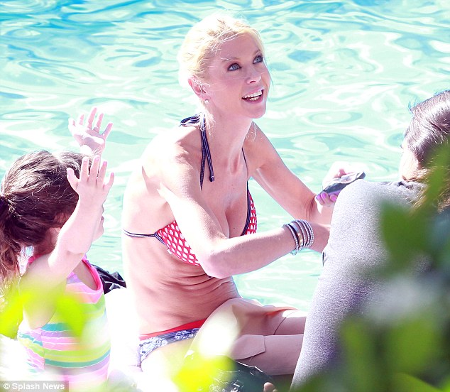 Pool day: Tara was treating her boyfriend Erez Eisen and his two children to a day out