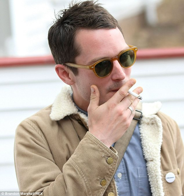 Bad boy! Elijah Wood puffed on a cigarette as he attended the Stanley Wood horror Film Festival in Colorado in Sunday