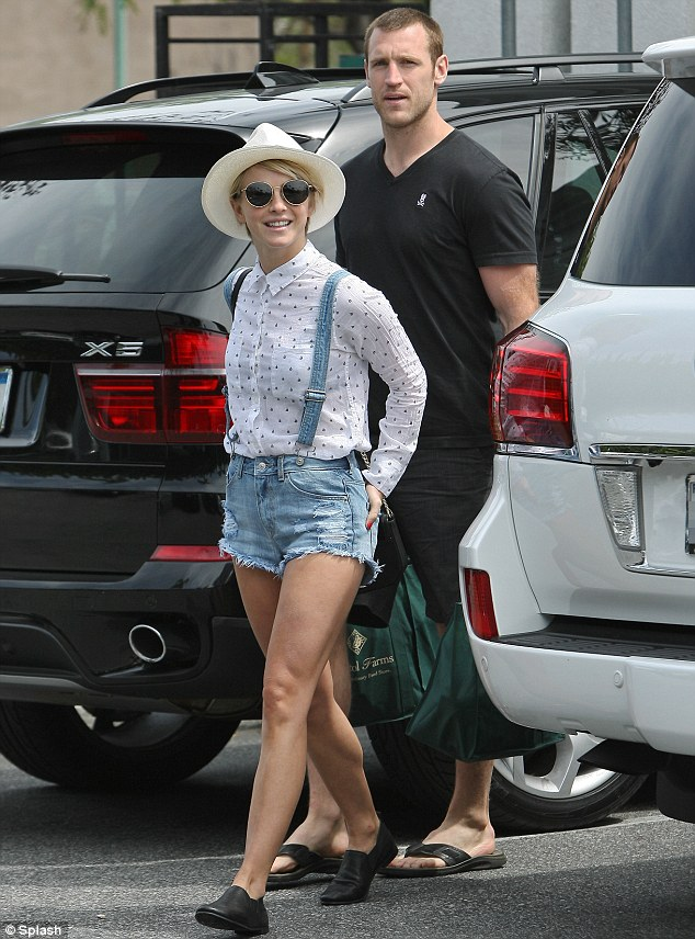 Stocking up: Julianne also sported a white hat and sunglasses