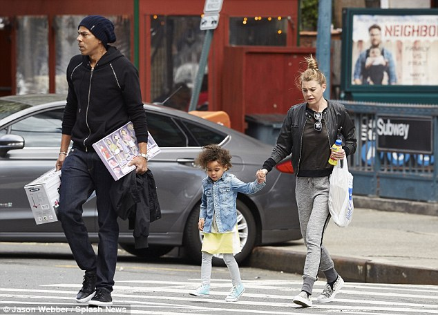 The happy family! Ellen Pompeo held her daughter Stella Luna's hand while walking alongside husband Chris Ivery while in New York on Sunday