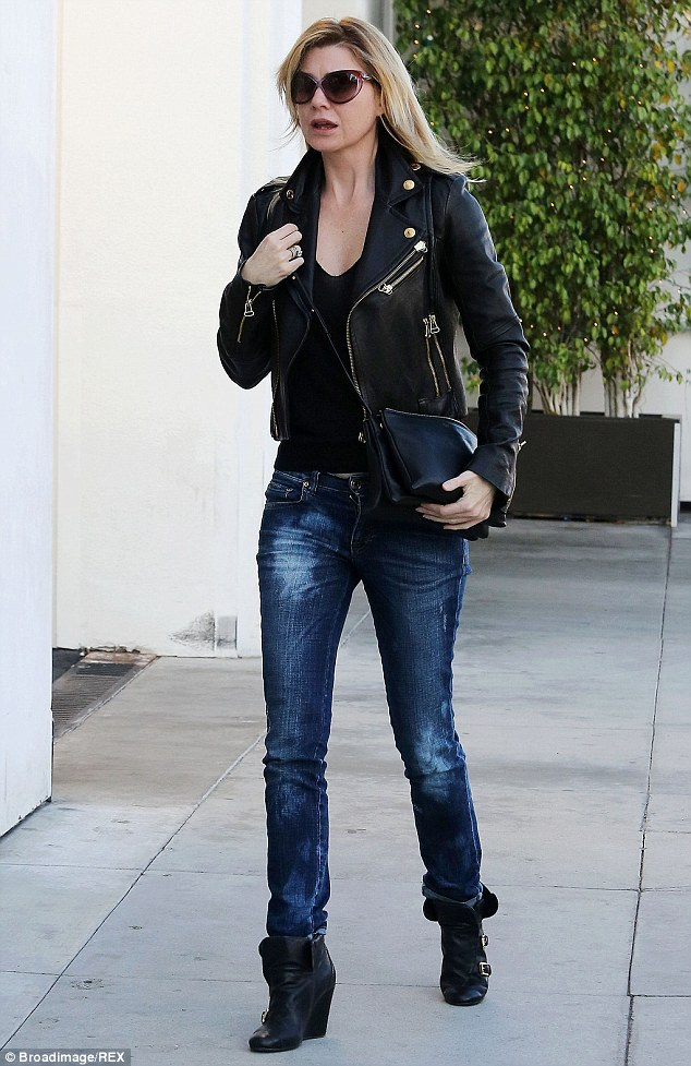 Looking good! Pompeo was a far cry from her New York self while strolling Los Angeles, dressed in a stylish black leather jacket and faded denim jeans in December 2013