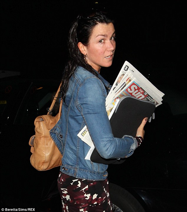 Early arrival: Susanna was without make-up as she arrived for her first day on the show clutching her laptop and the day's papers