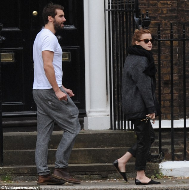 Step in time: Matthew walked slightly behind Emma as they strolled along the street together