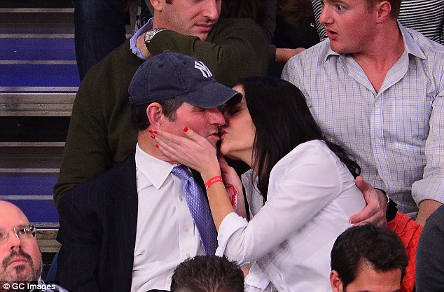 Spitzer and Smith, seen at a New York Knicks game in February, have been spotted canoodling all over town since he announced his divorce from wife of 26 years Silda