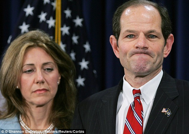 New York Governor Eliot Spitzer addresses the media with his wife Silda Wall Spitzer on March 10, 2008 following revelations that he spent $100,000 on prostitutes