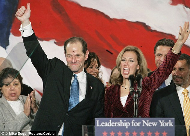 Eliot Spitzer and his wife Silda Wall Spitzer, pictured in November 2006 when he was elected NY governor. She stood by her husband following his call girl scandal in 2008 but the couple announced their divorce on Christmas Eve last year. Details of her multimillion-dollar divorce deal emerged today