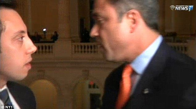 Run in: Grimm was caught on camera in January threatening NY1 reporter Michael Scotto (left) when he was asked about the campaign finance investigation