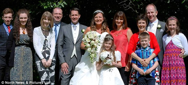 The couple, pictured with the wedding party after their 'second wedding', made a £7 million fortune and transformed their lifestyle by both working at Avon