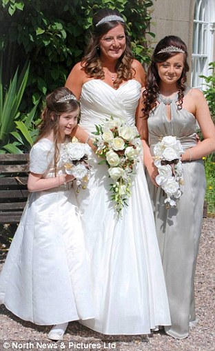 Having only been able to buy a £30 bridesmaid dress for her daughter Libby (now 16, right) at their first wedding, Gail splashed out £300 on the dress for her and little sister Rosie (left) this time
