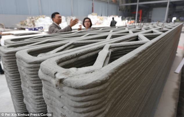 Hi-tech walls: Chinese firm Win Sun piped a mixture of cement and construction waste to build up walls layer by layer (pictured) in a speedy construction process that could transform the way affordable homes are built