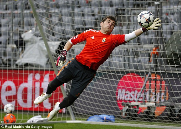 Flying save: Casillas' future has been heavily speculated with the Spain captain playing second fiddle at Real