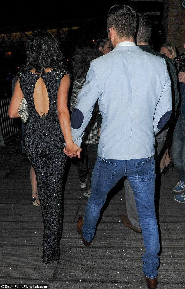 Close: Kym and Dan were photographed holding hands as they left the venue