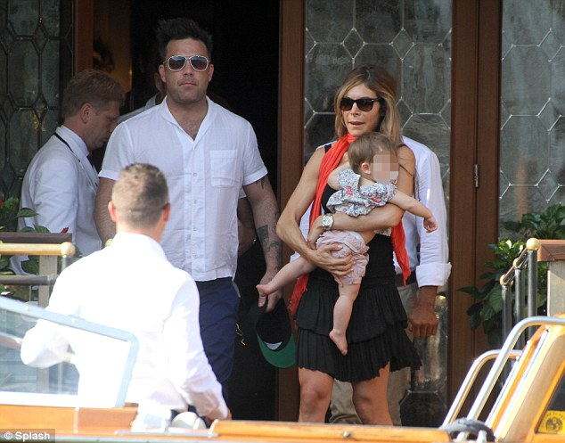 Young family: Robbie and his wife Ayda are parents to Theodora Rose, who is now two