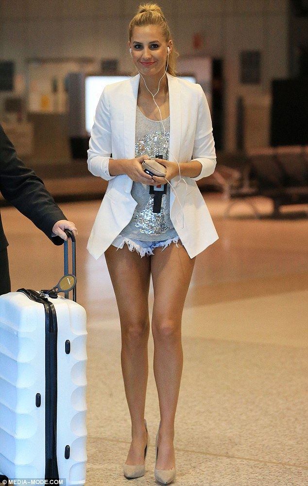 Blonde bombshell: Beauty pageant winner Laura Dundovic showed off her fit figure in tiny denim cut-off shorts at Sydney airport on Monday