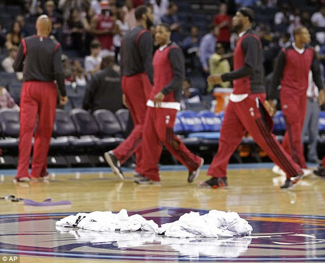 Warm-up shirts are piled at center court as Miami Heat players prepare for Game 4 of an opening-round NBA basketball playoff series against the Charlotte Bobcats in Charlotte, North Carolina, Monday, April 28, 2014