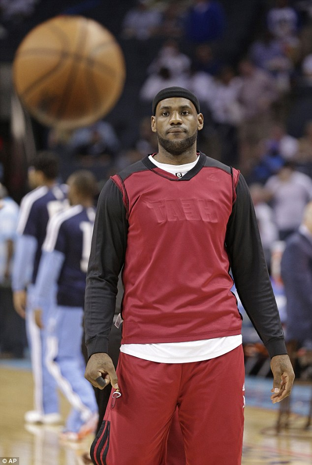 Miami Heat's LeBron James wears his warm-up jacket inside out as a show of solidarity to the Los Angeles Clippers