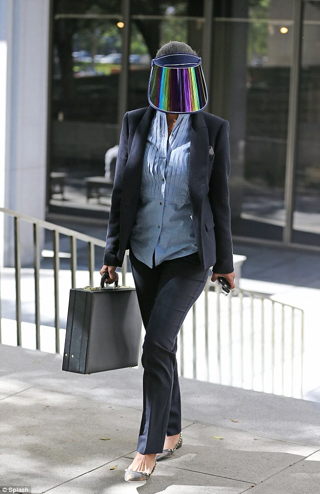 Vanessa Stiviano the women in the middle of the controversy with the Owner of the Clippers Donald Sterling was pictured Monday shielding her face with a strange visa