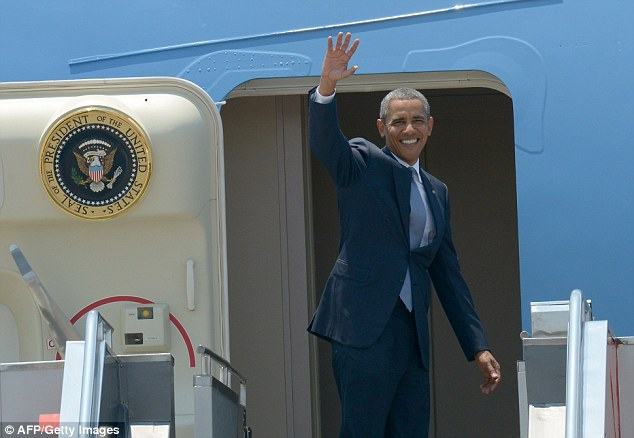 The Commander-in-chief waves as he boards Air Force One at Ninoy Aquino International Airport in Manila